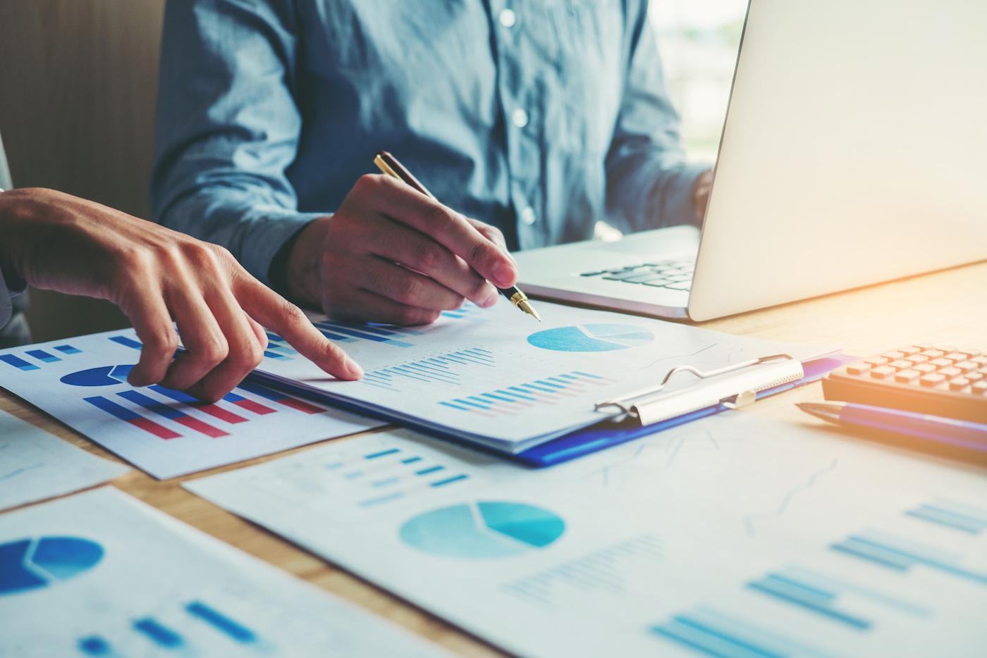 marketers analyzing social media reach